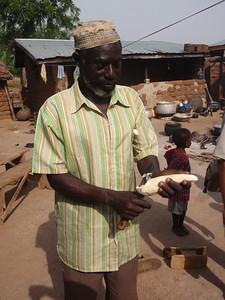 023_Between Tamale and Kumasi  Village Life  Peeling Casavas