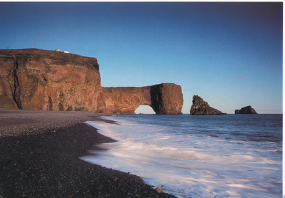 230_Dyrholaey_120m_headland_Natural_gate_has_been_eroded